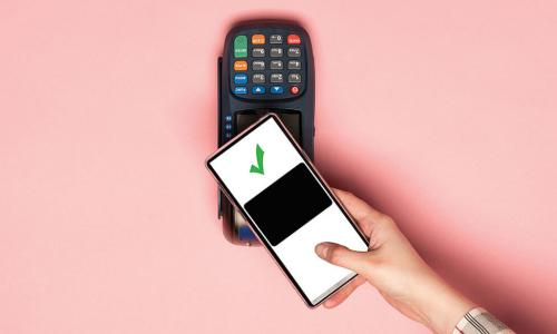 hand reaching out with smartphone to pay with digital wallet at contactless card reader