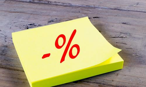 yellow sticky note with negative percentage sign