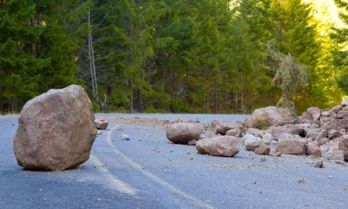 boulder and rock slide debris in the road