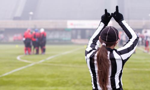 female referee on football field
