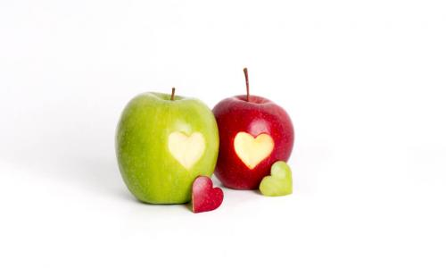 red and green apples with hearts