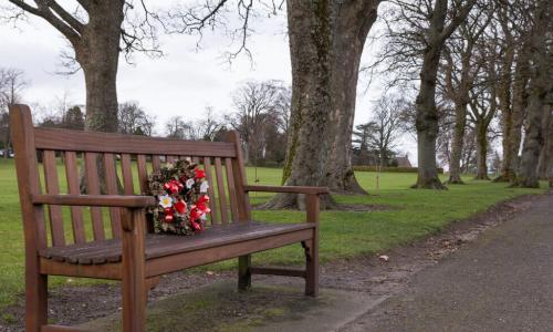bench with a memorial wreath along pathway
